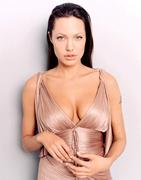 Анджелина Джоли(Angelina Jolie) в фотосессии Лоренцо Аджиуса(Lorenzo Agius) для журнала Premiere (июль 2003).