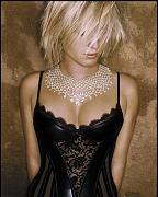 Ребекка Ромин (Rebecca Romijn) в фотосессии Рувена Афанадора (Ruven Afanador) (2002)