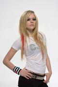 Аврил Лавин(Avril Lavigne) в фотосессии Сорена Солкаера(Soren Solkaer) для журналаQ (2007).